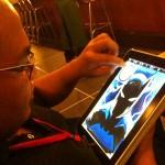 Heubert Khan Michael using an iPad