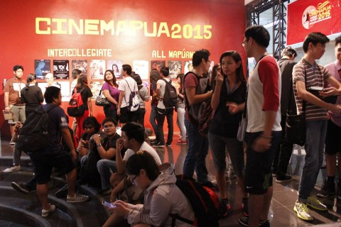 Students are eagerly waiting in queues for the screenings to start.