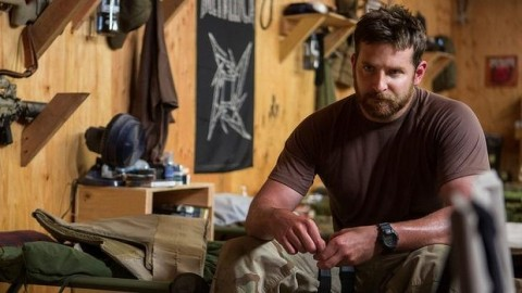 Bradley Cooper's Chris Kyle ponders the veracity of the war in American Sniper. Photo by Warner Bros Pictures.