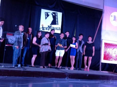 Ekselente Productions of FEU-Manila posing with CineMapua Adviser Benigno Agapito after receiving the Best Festival Film award.