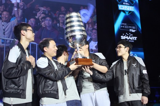 Wings Gaming celebrates with the trophy as Pinoy fans cheer them on