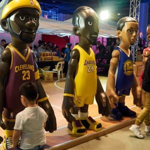 Big-headed basketball players. Would be cool if they were bobbleheads!