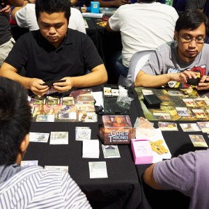 ToyCon guests playing card games.